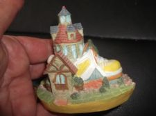 "COLLECTABLE MINIATURE COTTAGE BUILT INTO YELLOW TRAINER SHOE 3"" HIGH"